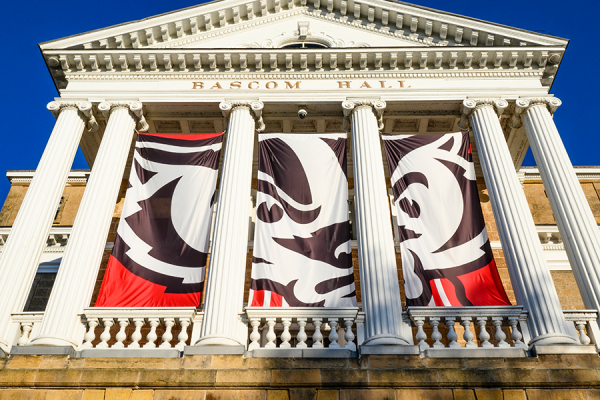 Exterior photo of Bascom Hall with Bucky Badger banner