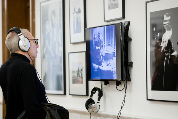 visitor listens to video presentation during gallery opening at lathrop hall