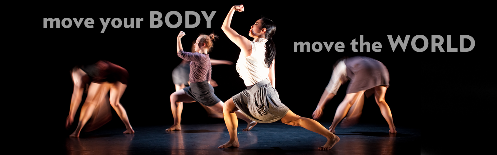 Photo of dancers on a dark stage. Two dancers are in a strong lunge stance with their fists in the air. Text on the image says move your body move the world